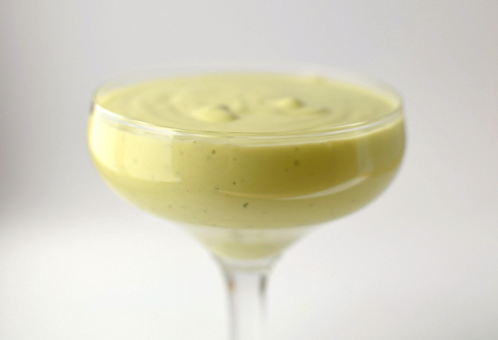 A glass filled with avocado ice cream base