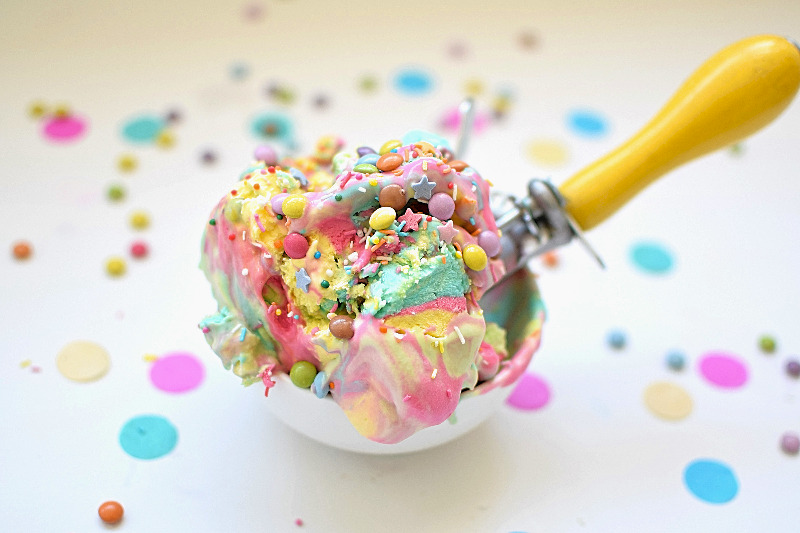 A scoop of ice cream with M&M minis on top.