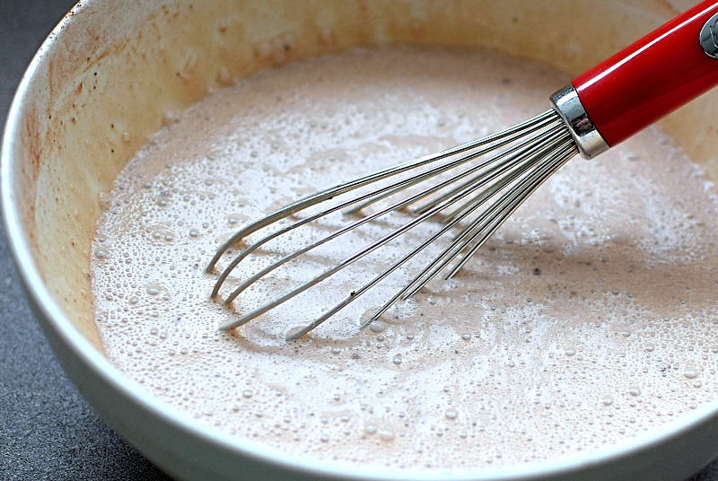 Blondie ice cream base in a white bowl with whisk